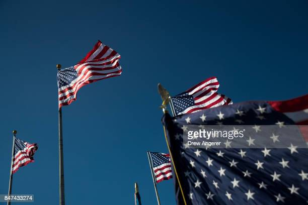 American flags fly during a naturalization ceremony at Liberty State Park September 15 2017 in Jersey City New Jersey To mark Citizenship Day 35...