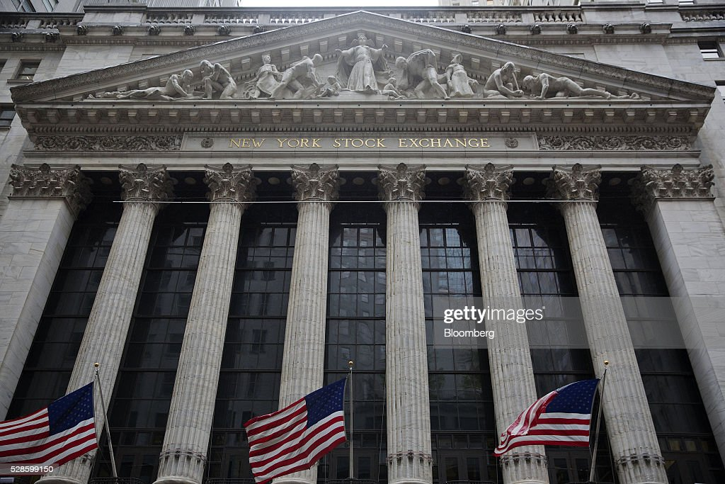 American flags fly outside of the New York Stock Exchange (NYSE) in New York, U.S., on Friday, May 6, 2016. U.S. stocks retreated a fourth day, with the S&P 500 poised for its first back-to-back weekly drop since February, after the smallest jobs gain in seven months raised doubts about the strength of the worlds largest economy. Photographer: Victor J. Blue/Bloomberg via Getty Images