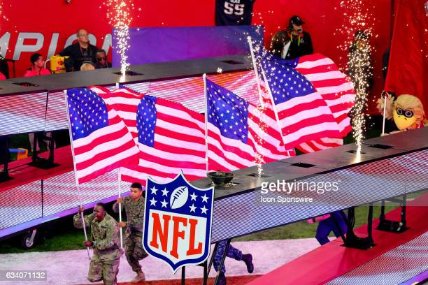 American Flags lead the Atlanta Falcons onto the field prior to Super Bowl LI on February 5 at NRG Stadium in Houston TX
