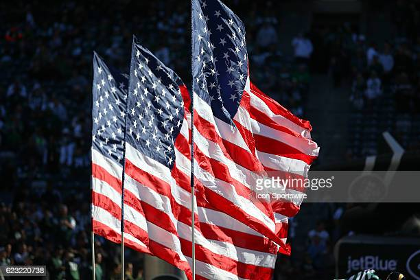American Flags lead the New York Jets onto the field prior to the National Football League game between the New York Jets and the Los Angeles Rams on...