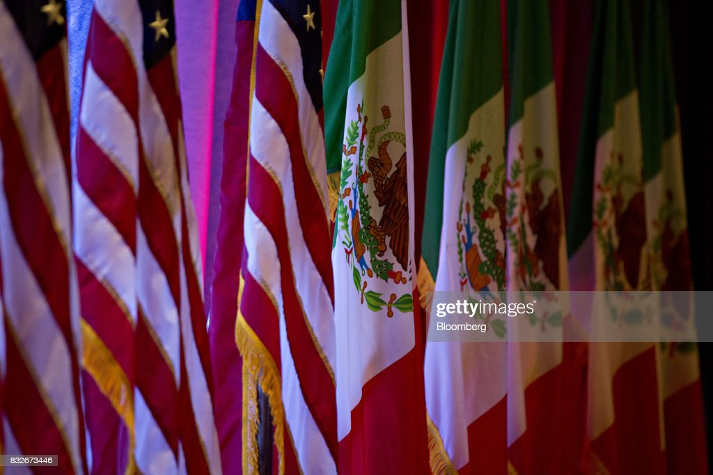 American flags, left, stand next to Mexican flags ahead of the first round of North American Free Trade Agreement (NAFTA) renegotiations in Washington, D.C., U.S., on Wednesday, Aug. 16, 2017. Canada and Mexico largely want to defend the advantages they have enjoyed under the two-decade-old Nafta deal, keep it free of tariffs and broaden it to new industries. President Donald Trump has called Nafta the worst trade pact in history and promised to fix it through negotiations or withdraw. Photographer: Andrew Harrer/Bloomberg via Getty Images