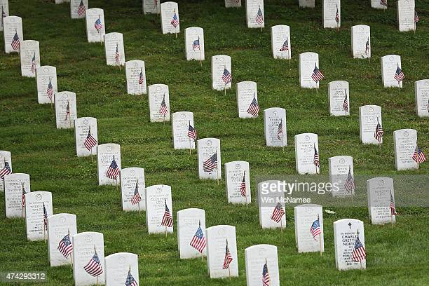 American flags placed by members of the 3rd US Infantry Regiment at the graves of US soldiers buried at Arlington National Cemetery in preparation...