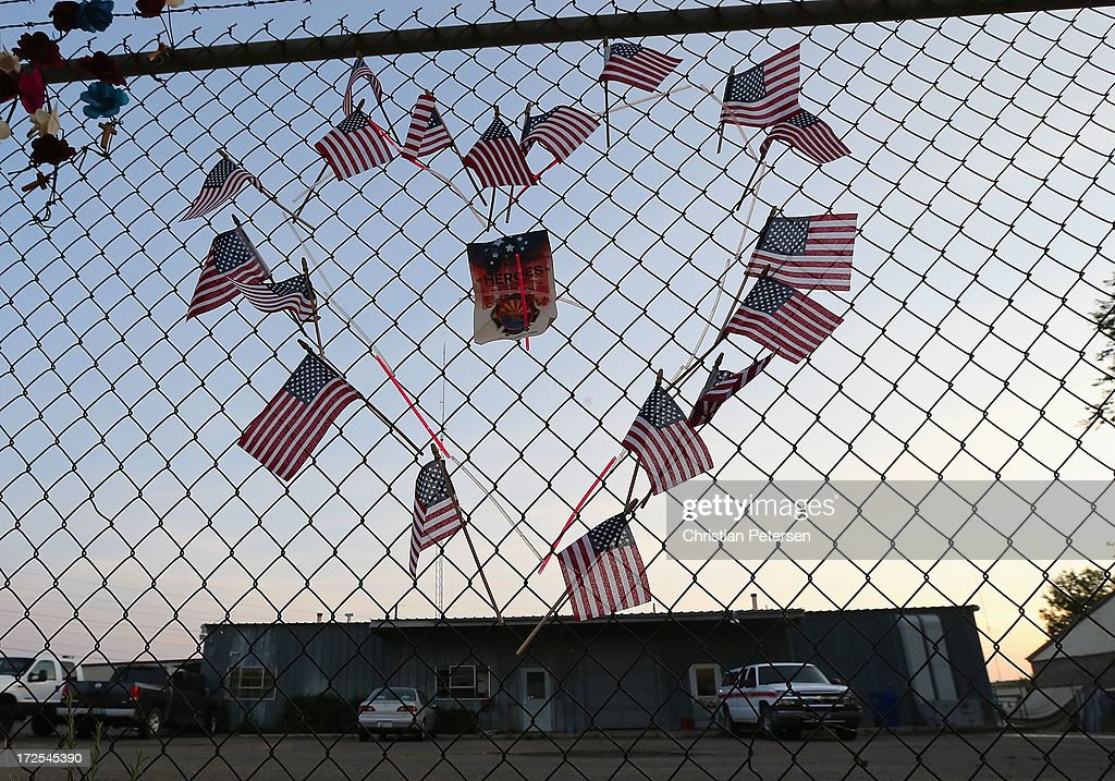 American flags, shaped in a heart, adorn the fence outside of Station 7 on July 3, 2013 in Prescott, Arizona. Nineteen firefighters based out of Station 7 died battling a fast-moving wildfire near Yarnell, Arizona on June 30. Station 7 has been the home of the Granite Mountain Interagency Hotshot Crew since 2010.