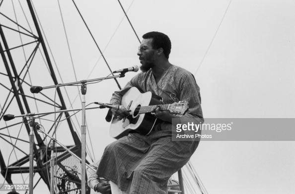 American folk singer and guitarist Richie Havens opening the Woodstock Festival at Bethel New York 15th August 1969