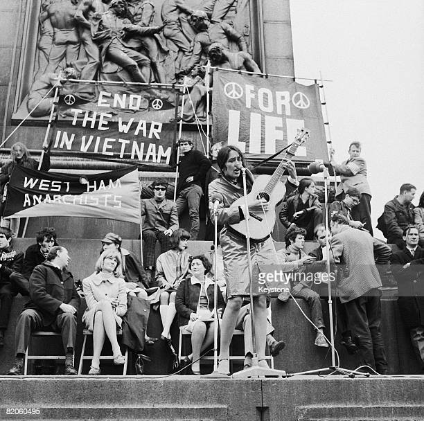 American folk singer Joan Baez performs at an antiVietnam War demonstration in London's Trafalgar Square 29th May 1965 Amongst her audience are...