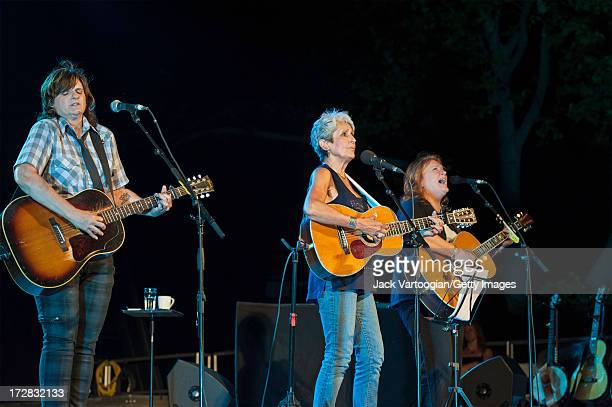American folk singer Joan Baez performs with the Indigo Girls at Central Park SummerStage New York New York June 17 2013 Pictured are from left Amy...