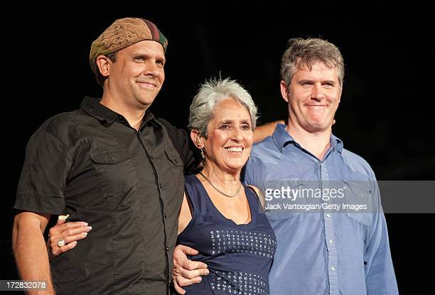 American folk singer Joan Baez takes a bow with her band her son and percussionist Gabe Harris and banjo player Dirk Powell at Central Park...