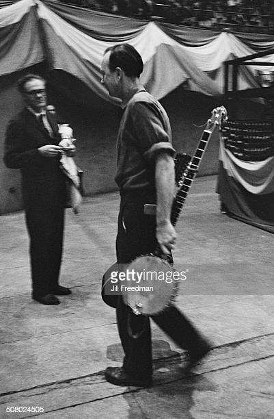 American folk singer Pete Seeger backstage at a SANE rally at Madison Square Garden New York City calling for an end to the Vietnam War USA December...