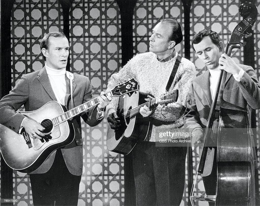 American folk singer <a gi-track='captionPersonalityLinkClicked' href=/galleries/search?phrase=Pete+Seeger&family=editorial&specificpeople=213821 ng-click='$event.stopPropagation()'>Pete Seeger</a> (center) performs with hosts Tom Smothers (left) and Dick Smothers during the taping on an episode of 'The Smothers Brothers Comedy Hour,' February 16, 1968. The episode was first broadcast February 25.