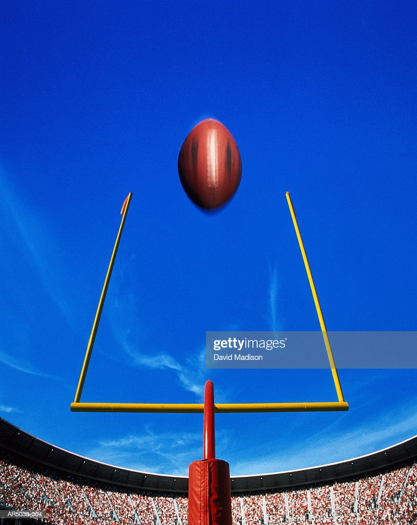American football, ball flying over goal (Digital Composite)