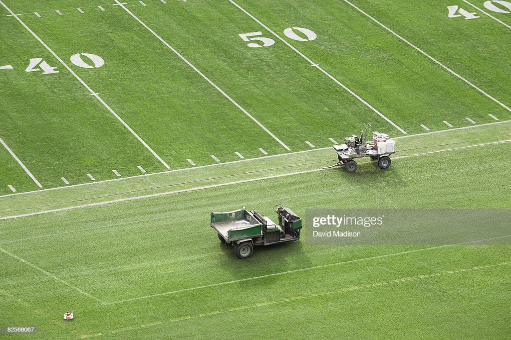 American football field being prepared for game. : Stock Photo