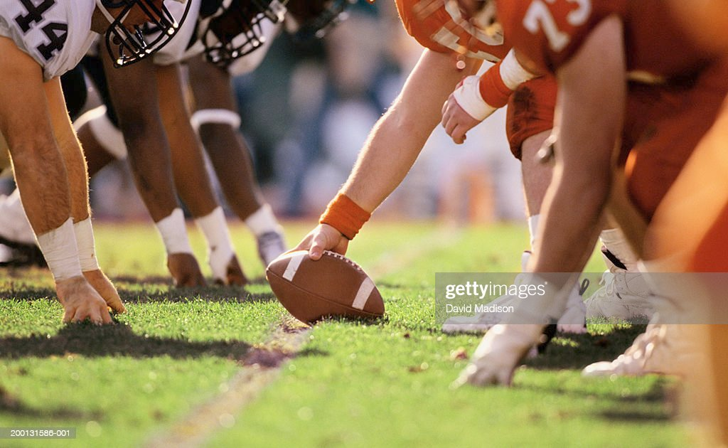 American football game, players at line of scrimmage, close-up
