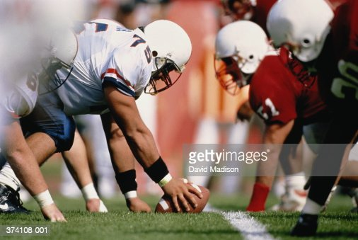 American football game,players in offensive line formation : Stock Photo