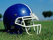 American football helmet in grass,close-up