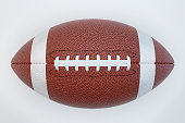 American football isolated on white background with clipping path. Super bowl. Top view. 3d render illustration