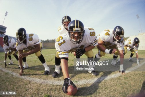 American Football offensive line : Stock Photo
