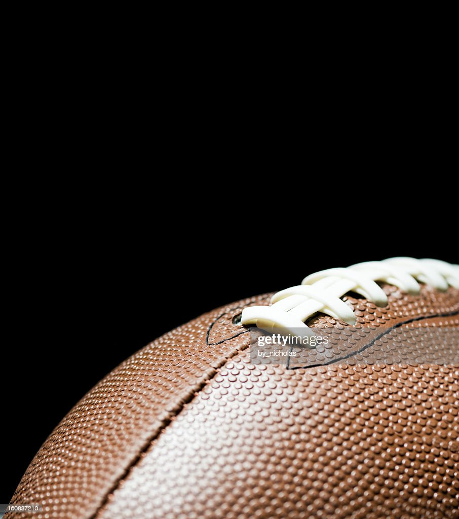 American football on black background : Stock Photo