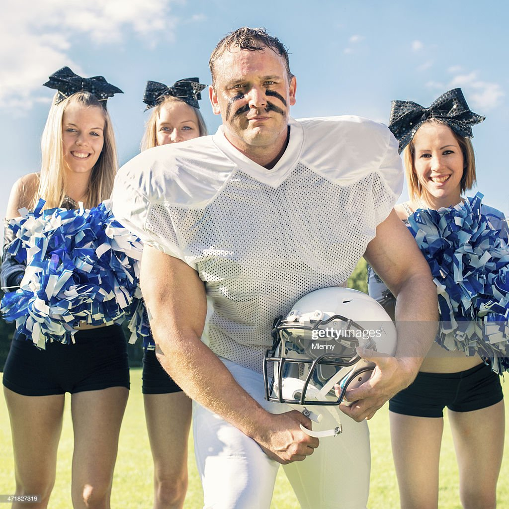 american football player and cheerleaders stock photo getty images