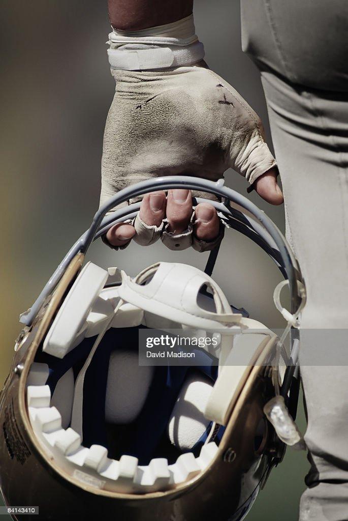 American football player carrying helmet : Stock Photo