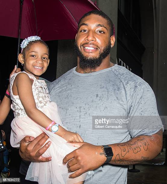 American football player/ defensive tackle Devon Still and his daughter Leah Still are seen arriving at Desigual fashion show during Spring 2016 New...