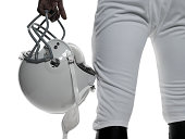American football player holding a helmet