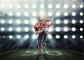 American football player in lights background