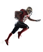 A male isolated american football player makes a dramatic play on white background.
