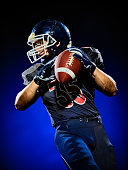 one american football player man isolated on colorful black background