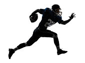 one caucasian american football player man running in silhouette studio on white background