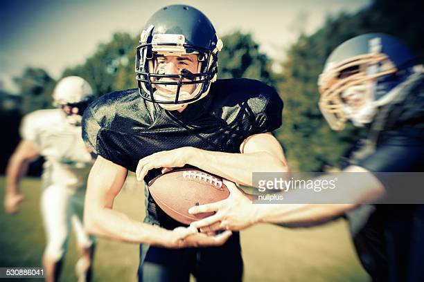 american football player passing the ball