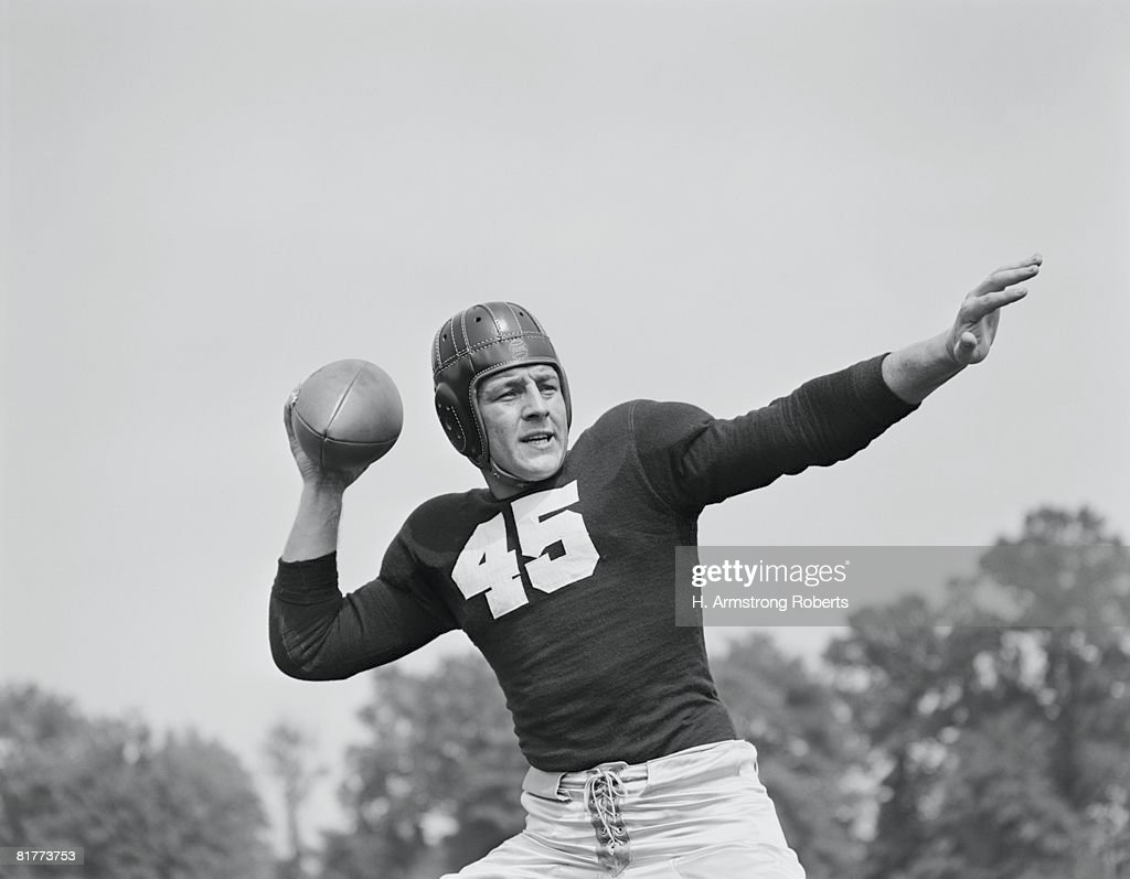 American football player poised to throw ball. : Stock Photo