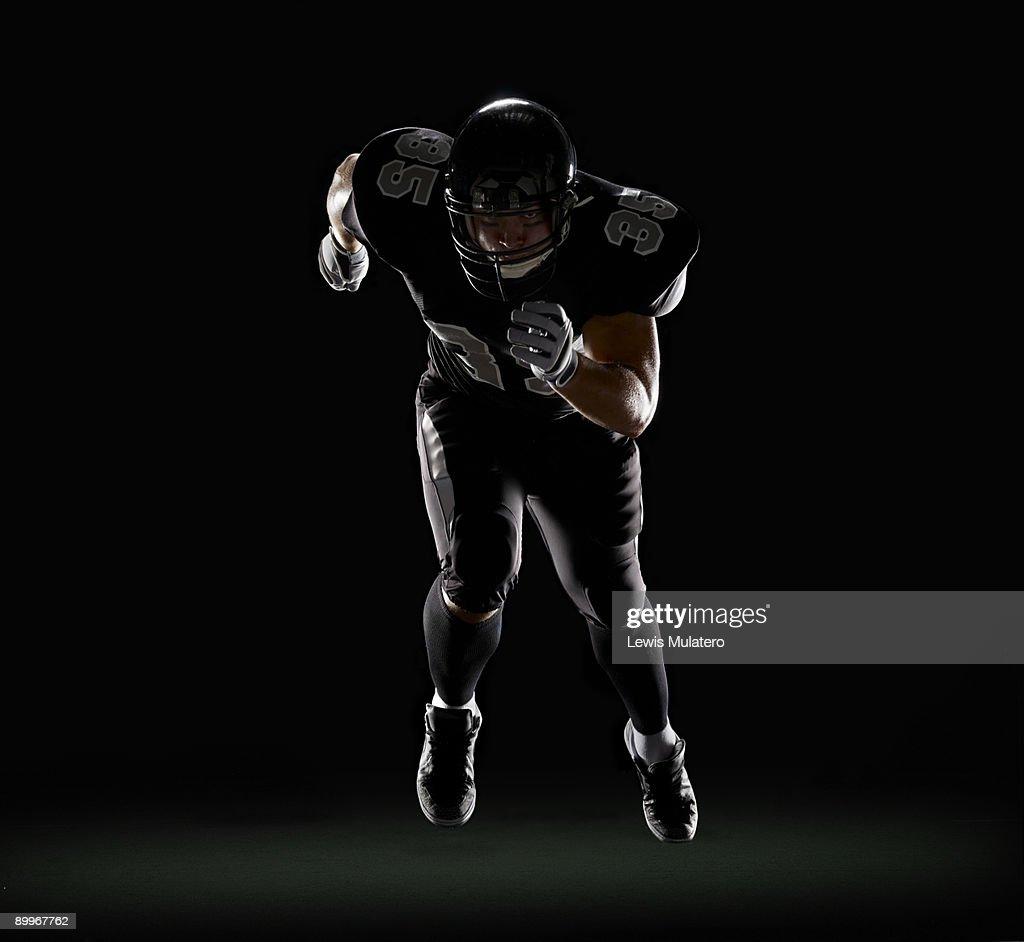 American football player running : Stock Photo
