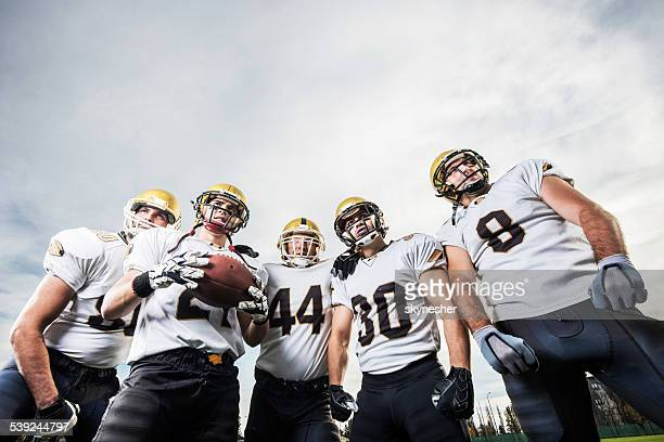 American football players against the sky.