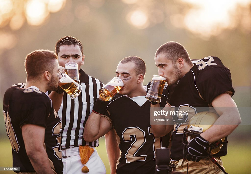 American Football Players drinking beer.