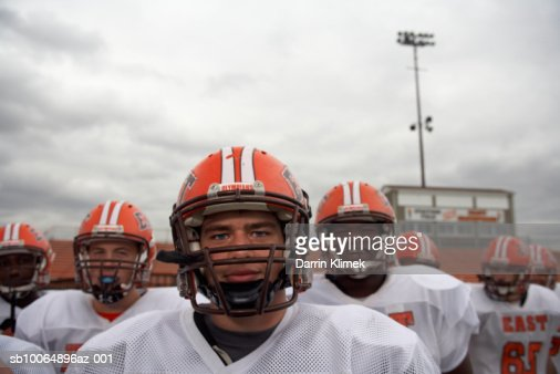 American football players including teenagers (15-17), group portrait (focus on foreground) : Stock Photo