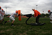 American football players including teenagers (15-17) training