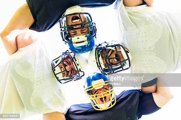 american football players posing