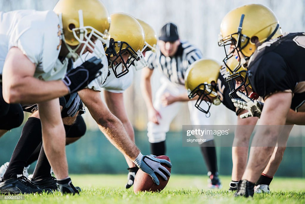 American football players positioning. : Stock Photo