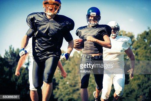 american football players running