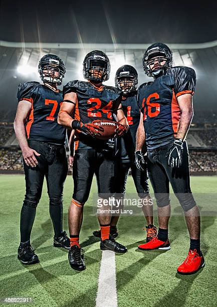American Football players standing in a stadium