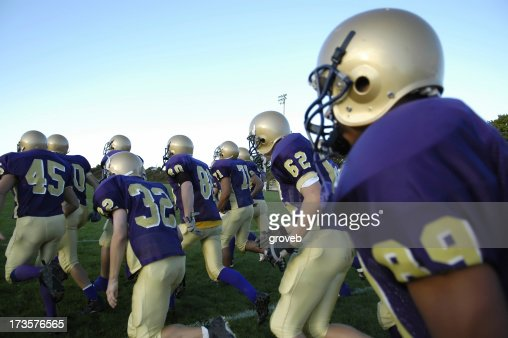 American Football team takes the field