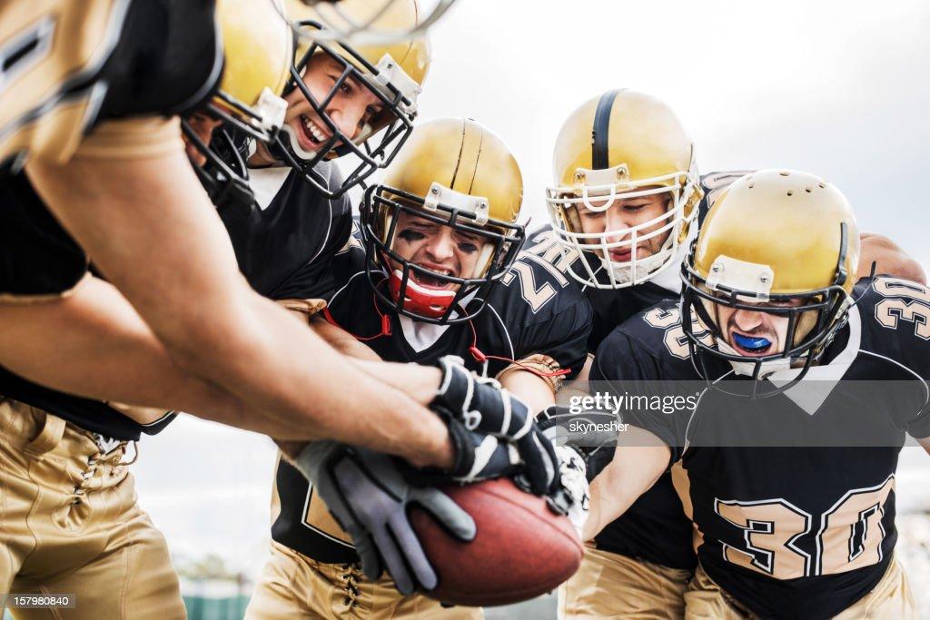 American Football teamwork. : Stock Photo