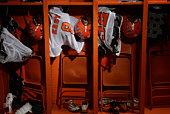 American football uniforms in locker room