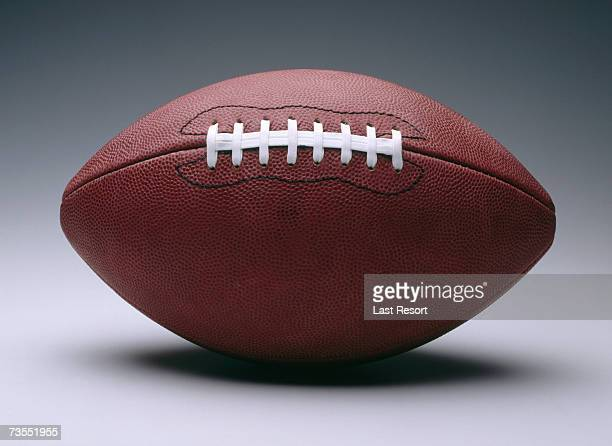 American football with white seam, plain background
