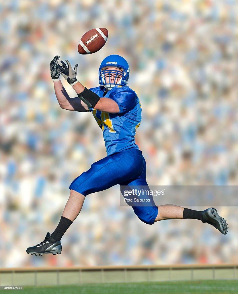 American footballer catching ball
