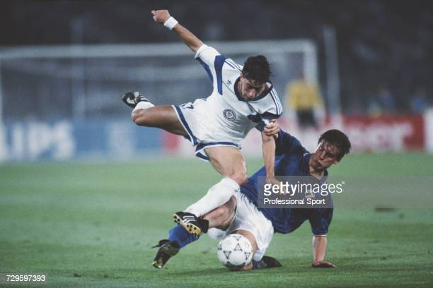 American footballer Marcelo Balboa is tackled by Italian midfielder Nicola Berti in the Group A match between Italy and the United States in the 1990...