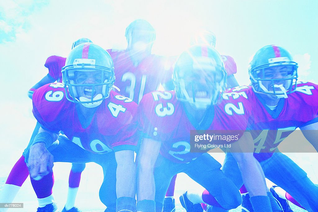 American Footballers in a Scrimmage Line : Stock Photo