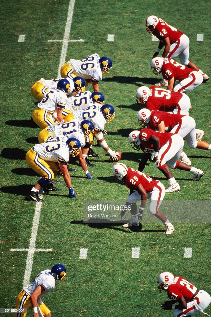 American football,teams in formation at line scrimmage : Stock Photo