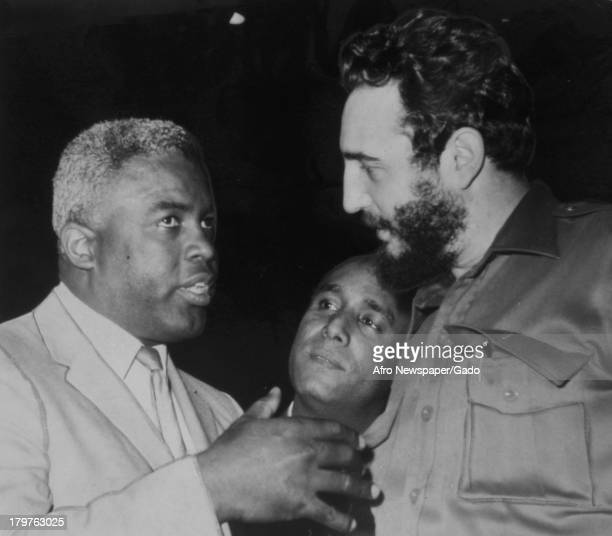 American former baseball player Jackie Robinson of the Brooklyn Dodgers greets Fidel Castro at the Overseas Press Club Luncheon New York New York...