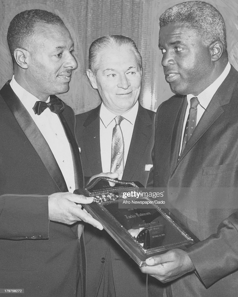 American former baseball player Jackie Robinson of the Brooklyn Dodgers receives The Man of the Year Award at National Association for the...